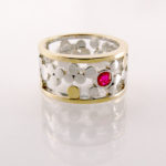 Ring of Circles, 10K white and yellow gold with ruby